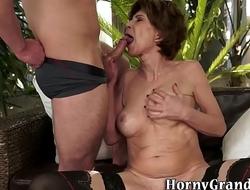 Old granny rubs her cunt